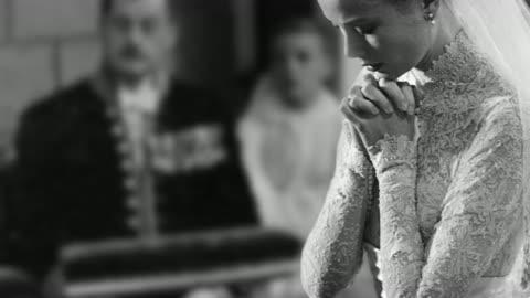 grace kelly prays during her wedding to prince rainier of monaco. - royalty stock videos & royalty-free footage