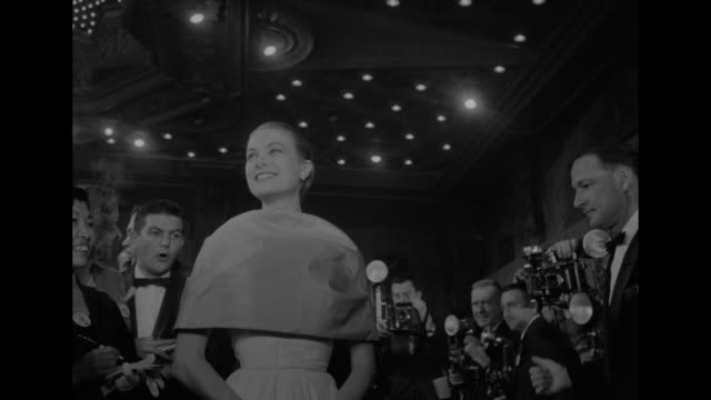 grace kelly surrounded by press photographers and reporters at the academy awards - actress stock videos & royalty-free footage