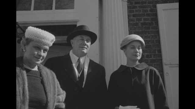 grace kelly with mother margaret majer kelly father john b kelly on front steps of their home / cu kelly in hat prince bought for her / 3shot /as... - grace kelly actress stock videos & royalty-free footage