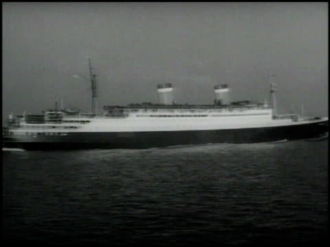 grace line ss santa lucia ocean liner, bow, vs passenger liner. businessman joseph kennedy working w/ papers at desk. - anmut stock-videos und b-roll-filmmaterial