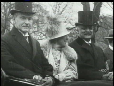grace + president calvin coolidge sit next to man in car - anno 1927 video stock e b–roll