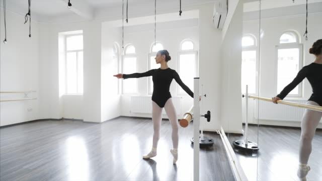 graceful ballerina warming up. - ballroom stock videos & royalty-free footage