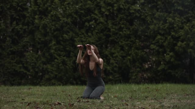 graceful ballet dancer in backyard dancing on grass in bare feet in isolation - elastane video stock e b–roll