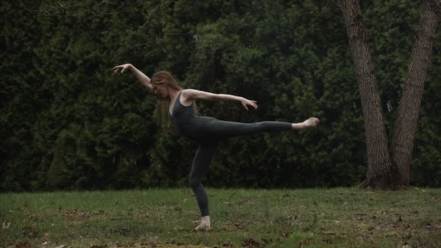 graceful ballet dancer in backyard dancing on grass in bare feet in isolation - leotard stock videos & royalty-free footage