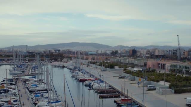 Graded footage - Aerial - Drone - flying into a marina at Faliro Bay - Athens, Greece