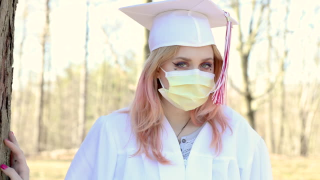 graduate outdoors with face mask - female high school student stock videos & royalty-free footage