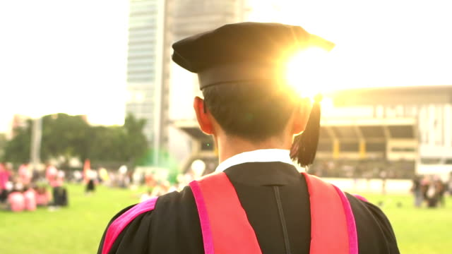 graduate students with sunset. - graduation stock videos & royalty-free footage
