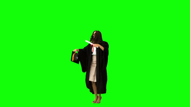 graduated student in slow motion throwing her hat - cappello video stock e b–roll