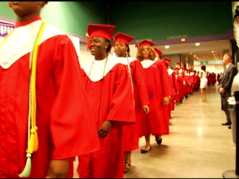 graduates in cap and gown walking in graduation - graduation gown stock videos and b-roll footage