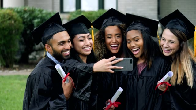 graduates run to join a self portrait - cap stock videos & royalty-free footage
