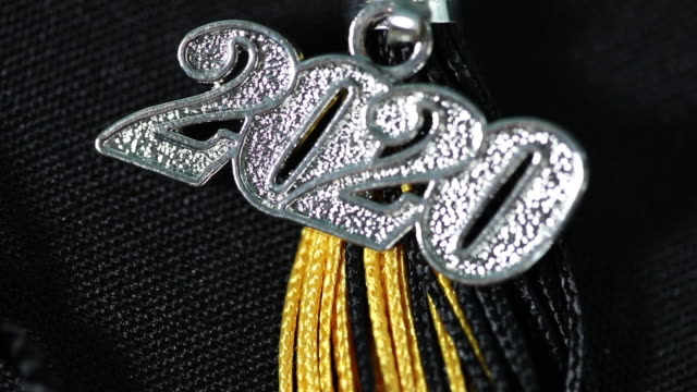 graduation 2020 charm going out of focus - tassel stock videos & royalty-free footage