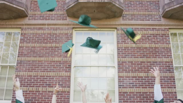 graduation caps in the air - hat stock videos & royalty-free footage