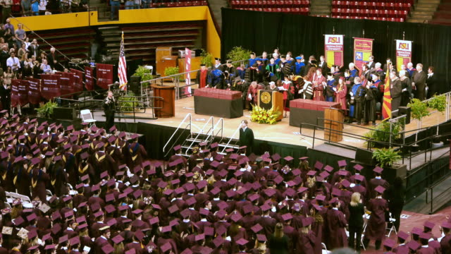 ws asu graduation ceremony diginitairies on elevated dais and graduating students / phoenix, arizon, usa - auditorium stock videos & royalty-free footage