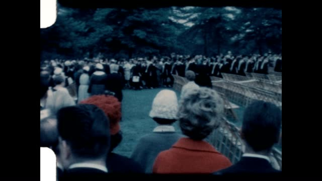 stockvideo's en b-roll-footage met graduation for hunter college in the early 1960's - diploma