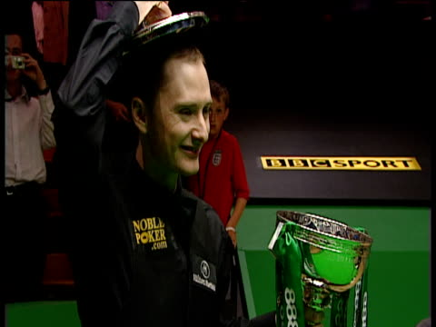 graeme dott poses with trophy lid on his head following his victory over peter ebdon world snooker championship final crucible theatre sheffield 01... - world championship stock videos & royalty-free footage