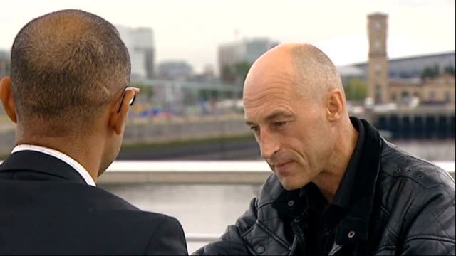 graeme obree to attempt to break world land speed record scotland ext obree interview with reporter in shot sot - world record stock videos and b-roll footage