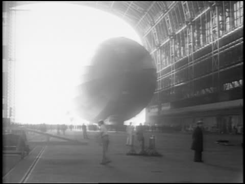 B/W 1929 Graf Zeppelin moving into hangar / Lakehurst, NJ / newsreel
