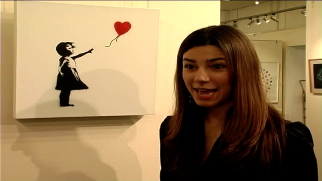 graffiti artist banksy's work auctioned at sotheby's ellie varnavides interview sot - サザビーズ点の映像素材/bロール