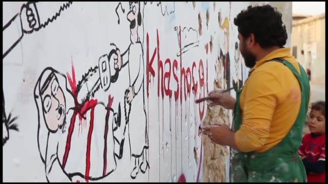 a graffiti artist in syria's idlib is painting the walls of buildings damaged by airstrikes to show solidarity with murdered saudi journalist jamal... - columnist stock videos & royalty-free footage