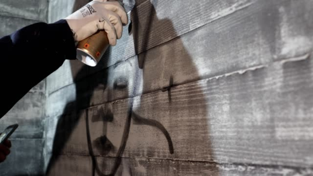 graffiti artist making contour graffiti lines on a wall with aerosol can - aerosol can stock videos & royalty-free footage