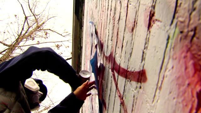 graffiti artist painting urban wall - hood clothing stock videos & royalty-free footage