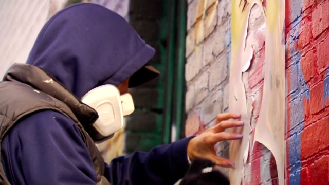graffiti artist painting urban wall - spray painting stock videos & royalty-free footage