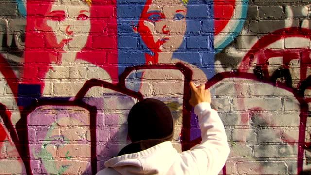 graffiti artist painting urban wall - graffiti stock videos and b-roll footage
