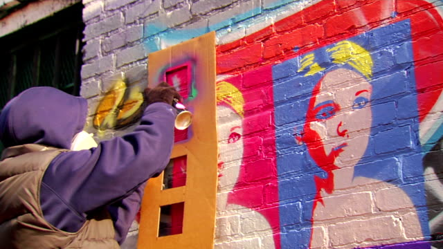 graffiti artist paints with stencil - artist stock videos & royalty-free footage