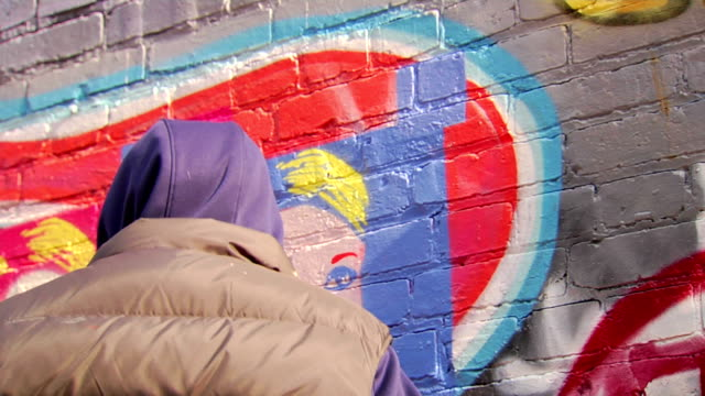 graffiti artist paints with stencil - cu - stencil stock videos & royalty-free footage