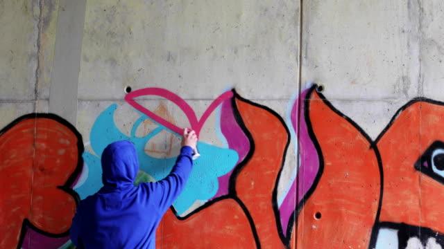 graffiti artist spraying graffiti on wall - mural stock videos & royalty-free footage