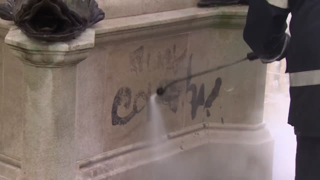 graffiti cleaned from the plinth of the edward colston statue, a 17th century merchant who made money from the slave trade, after it was pulled down... - bristol england stock videos & royalty-free footage