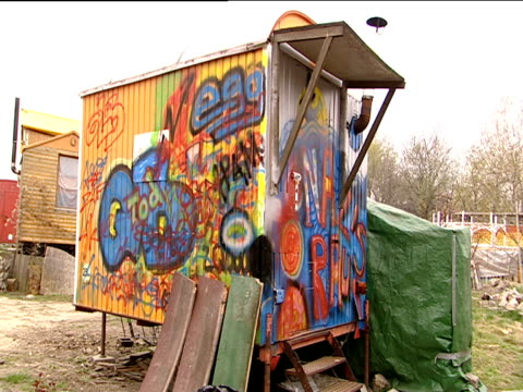 graffiti covered single berth cabin in new age commune east berlin - new age stock videos and b-roll footage