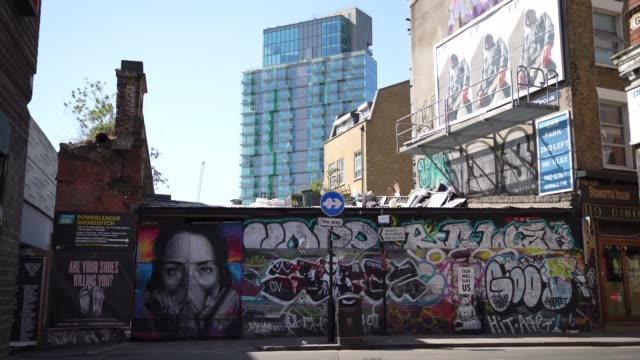 graffiti from artist bk foxx wearing her graffiti mask created by french street artist zabou in east london on april 20 during the coronavirus... - artist stock videos & royalty-free footage