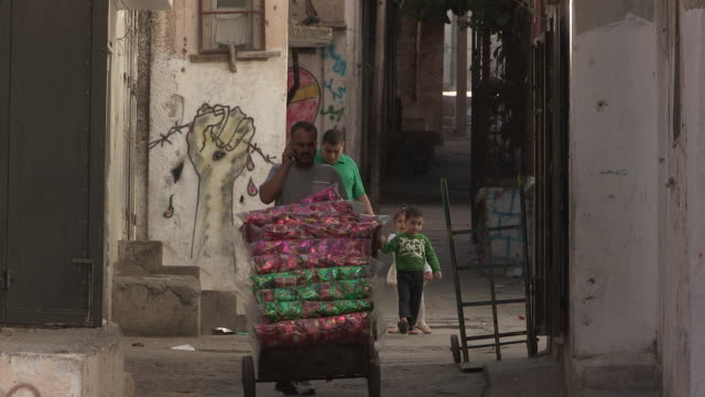 graffiti in an alley, balata refugee camp, palestine - palestinian territories stock videos and b-roll footage