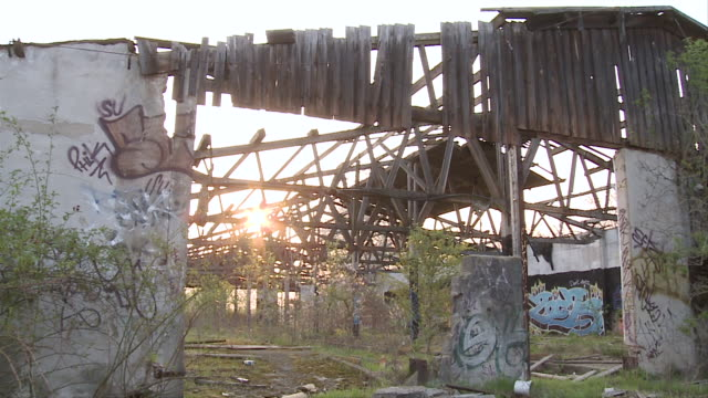 ms pan graffiti on abandoned building / brandenburg, germany   - east germany stock videos and b-roll footage