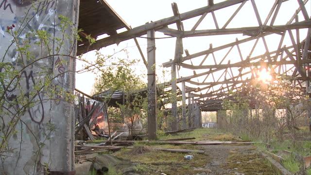 ws pov graffiti on abandoned building / brandenburg, germany   - cold war stock videos & royalty-free footage