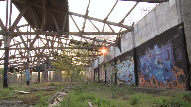 ws pov graffiti on building in eastern / brandenburg, germany   - east germany stock videos and b-roll footage
