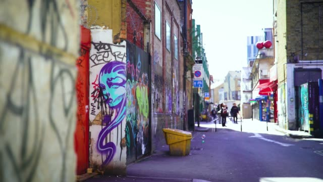 graffiti on electric lane in brixton, london - dustbin stock videos & royalty-free footage