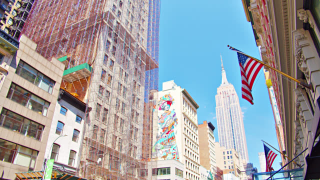 stockvideo's en b-roll-footage met graffiti on residential district. empire state building and american flag. concept. - menselijke vorm