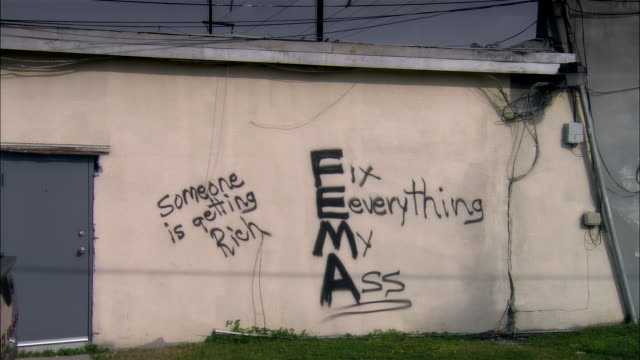 ms, graffiti on wall, new orleans, louisiana, usa - hurricane katrina stock videos and b-roll footage