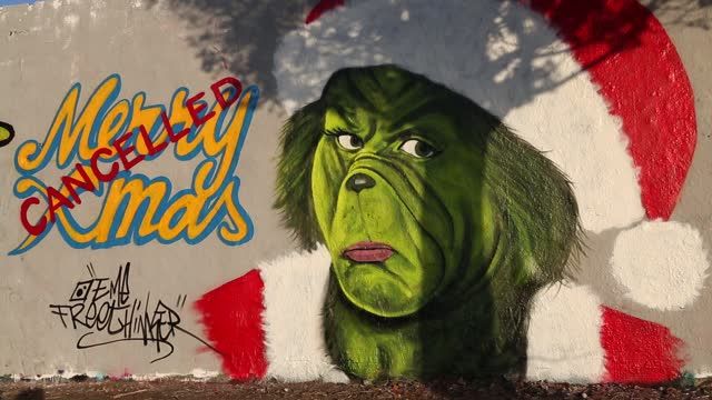 graffiti proclaiming the cancellation of christmas, featuring the dr. seuss grinch character, is seen on a section of the former berlin wall amidst a... - event stock videos & royalty-free footage
