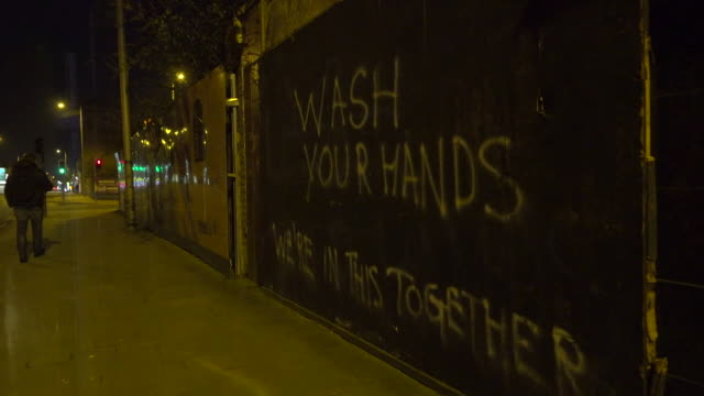graffiti saying 'wash your hands, we're in this together' in east belfast during the coronavirus crisis - belfast stock videos & royalty-free footage