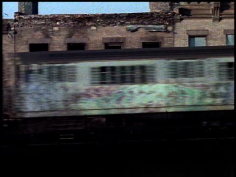 1982 ws graffiti-covered train running on elevated track / bronx, new york city, new york, united states - 1982 stock videos and b-roll footage