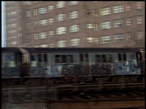 1982 ws graffiti-covered train running on elevated track / bronx, new york city, new york, united states - bronx new york stock videos and b-roll footage