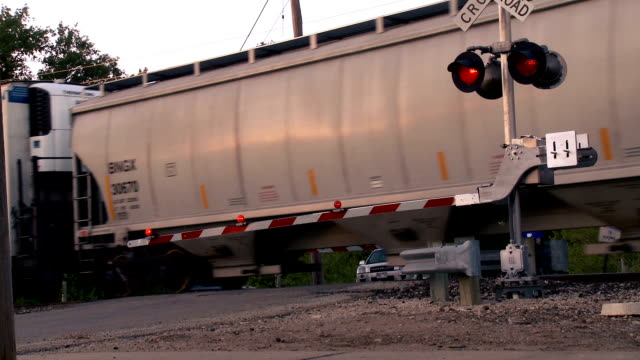 graffittied train passing the cross guard - rail freight stock videos and b-roll footage