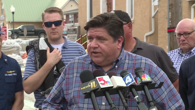 ktvi grafton il us il governor jb pritzker speaks after touring the flooded community in grafton and the greater surrounding area on tuesday june 4... - umgeben stock-videos und b-roll-filmmaterial