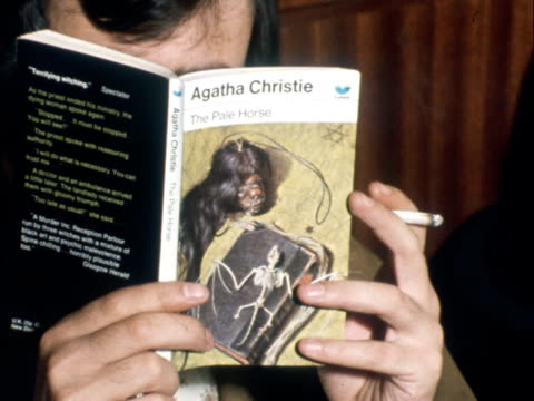 london cs hands hold paperback by agatha christie 'the pale horse' which listed thallium as a poison cms death certificate of robert egle cs 'name... - paperback stock videos & royalty-free footage