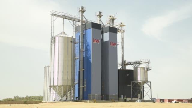 grain silos stand at a compagnie agricole de saintlouis du senegal rice processing and storage facility in saintlouis senegal on tuesday nov 22 2016 - saint louis bildbanksvideor och videomaterial från bakom kulisserna
