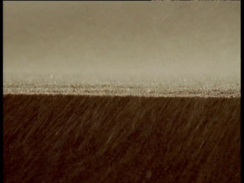 grains of sand blow about in namib desert - sandstorm stock videos & royalty-free footage