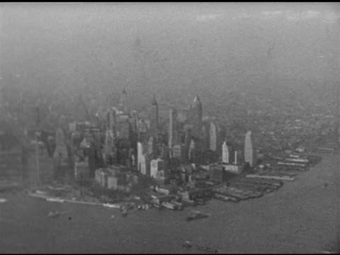 grainy aerial financial district, southern tip of manhattan island, fog bg. midtown w/ chrysler building , queensboro bridge & neighborhood of queens... - chrysler building stock videos & royalty-free footage